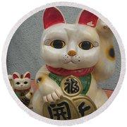 A Figure Of A Beckoning Cat, Called 'manekineko' Round Beach Towel