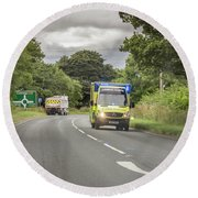 Round Beach Towel featuring the photograph On The Way To Help by RKAB Works