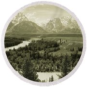 River Flowing Through A Landscape Round Beach Towel