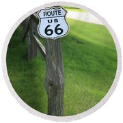 Round Beach Towel featuring the photograph Route 66 Shield And Fence Post by Frank Romeo
