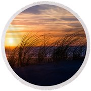 Round Beach Towel featuring the photograph sunset at the North Sea by Hannes Cmarits