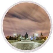 Winter Night At Charles Bridge, Prague, Czech Republic Round Beach Towel