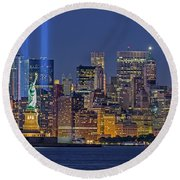 Round Beach Towel featuring the photograph World Trade Center Wtc Tribute In Light Memorial II by Susan Candelario