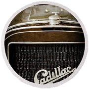 Round Beach Towel featuring the photograph 1907 Cadillac Model M Touring Grille Emblem -1106ac by Jill Reger