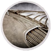 Round Beach Towel featuring the photograph 1934 Desoto Airflow Coupe Hood Ornament -2404ac by Jill Reger