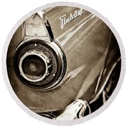 Round Beach Towel featuring the photograph 1956 Ford Thunderbird Taillight Emblem -0382s by Jill Reger