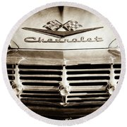 Round Beach Towel featuring the photograph 1959 Chevrolet Impala Grille Emblem -1014s by Jill Reger