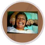 Round Beach Towel featuring the photograph 1960s Dental Exam by Peter Gumaer Ogden