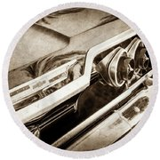 Round Beach Towel featuring the photograph 1963 Chevrolet Taillight Emblem -0183s by Jill Reger