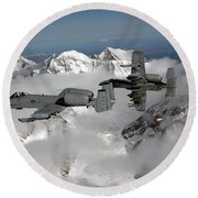 Round Beach Towel featuring the photograph A-10 Thunderbolt IIs Fly by Stocktrek Images