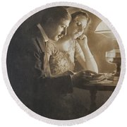 Vintage Loving Couple Reading With Oil Lamp Round Beach Towel