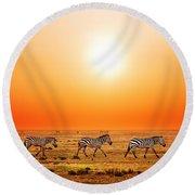 Zebras Herd On African Savanna At Sunset. Round Beach Towel