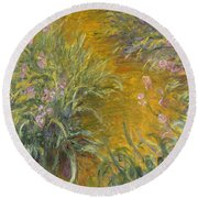 The Path Through The Irises Round Beach Towel by Claude Monet