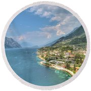view over the Lake Garda with the charming village Malcesine Round Beach Towel