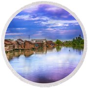 Round Beach Towel featuring the photograph Village by Charuhas Images