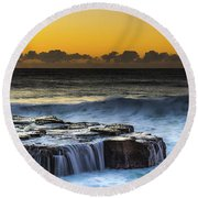 Sunrise Seascape With Cascades Over The Rock Ledge Round Beach Towel