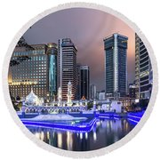 The Office Buildings Reflects In The Water Of The Klang River In Round Beach Towel