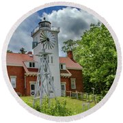 Round Beach Towel featuring the photograph 40 Mile Point Lighthouse by Bill Gallagher