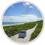 4wd Car Exploring Remote Track On Sand Island Round Beach Towel