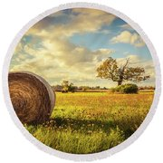 A Bale Of Hay And A Tree Round Beach Towel