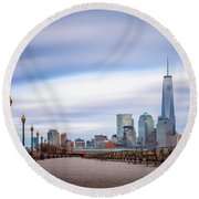 A Boardwalk In The City Round Beach Towel
