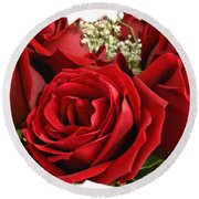 Round Beach Towel featuring the photograph A Bouquet Of Red Roses by Sue Melvin