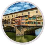Ponte Vecchio On The Arno River Under A Blue Sky In Florence, Italy Round Beach Towel