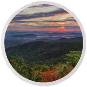 Round Beach Towel featuring the photograph A Colorful Sunrise by Lori Coleman