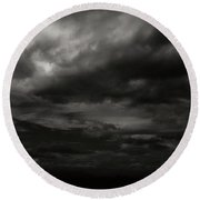 Round Beach Towel featuring the photograph A Dark Moody Storm by John Norman Stewart
