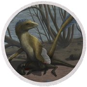 A Deinonychus Protects Its Kill Round Beach Towel