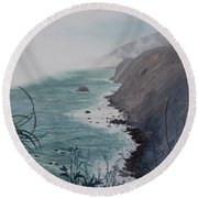 A Fog Creeps In Round Beach Towel