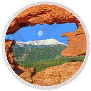 A Glimpse Of The Mighty Rockies Through A Rocky Window  Round Beach Towel