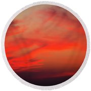 a gorgeous sunset with luminous red clouds over the Yala Nationalpark Round Beach Towel