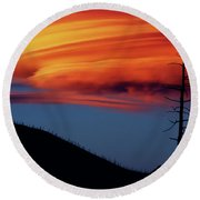 A Haunting Sunset Round Beach Towel