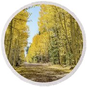 A Lane Of Gold Round Beach Towel