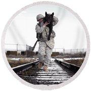 A Military Dog Handler Uses An Round Beach Towel
