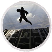 A Paratrooper Salutes As He Jumps Round Beach Towel