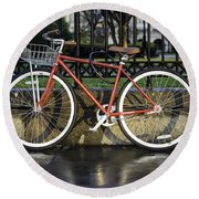 A Red Bicycle Near Jackson Square, New Orleans, Louisian Round Beach Towel