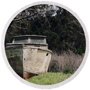 A Retired Old Fishing Boat On Dry Land In Bodega Bay Round Beach Towel