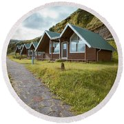 Round Beach Towel featuring the photograph A Row Of Cabins In Iceland by Edward Fielding