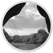 Round Beach Towel featuring the photograph A Rugged View by Natalie Ortiz