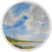 A Secluded Inlet Beneath Billowing Clouds Round Beach Towel