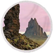 A Shiprock Landscape Against A Pink Dawn Sky Round Beach Towel