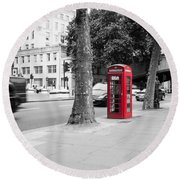 A Single Red Telephone Box On The Street Bw Round Beach Towel