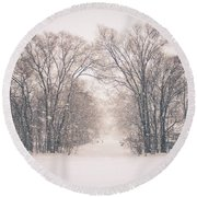 A Snowy Monday Round Beach Towel