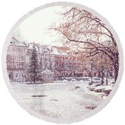 Round Beach Towel featuring the photograph A Street In Warsaw, Poland On A Snowy Day by Juli Scalzi