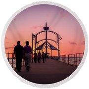 A Stroll Along Sunset Pier Round Beach Towel