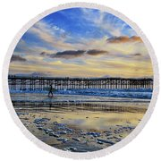 A Surfer Heads Home Under A Cloudy Sunset At Crystal Pier Round Beach Towel