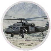 Round Beach Towel featuring the photograph A Uh-60 Blackhawk Helicopter by Stocktrek Images