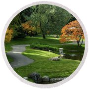 A Walk In The Garden Round Beach Towel